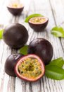 Passion fruits on wooden background Royalty Free Stock Photography