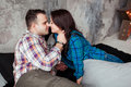 Passionate beautiful couple in bedroom enjoying foreplay Royalty Free Stock Photo