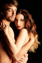 Passionate couple beautiful naked in love over black background Stock Photo
