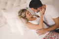Passionate couple foreplay in bed Royalty Free Stock Photo