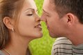 Passionate couple before kiss with eyes closed faces in closeup Royalty Free Stock Photography