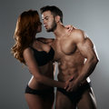 Passionate couple in studio on a gray background Royalty Free Stock Image