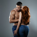 Passionate couple in studio on a gray background Royalty Free Stock Photography