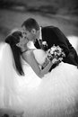 Passionate kiss black and white portrait of newly married couple kissing Royalty Free Stock Image
