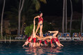 Great closeup view of  professional Cuban dancers at night show in watter pool