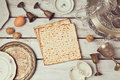 Passover background with matzoh on wooden table. View from above. Royalty Free Stock Photo