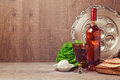 Passover background with wine bottle, matzoh, egg and seder plate Royalty Free Stock Photo