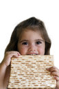 Passover jewish holiday girl eating a matzo in jewsih Stock Image