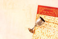 Passover plate wine cup and matzoh. Stock Photography