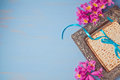 Passover spring holiday background with matzoh and flowers. Royalty Free Stock Photo