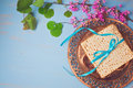 Passover spring holiday background with matzoh, seder plate and flowers. Royalty Free Stock Photo