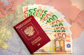 Passport with euro on the map bills in Stock Photo