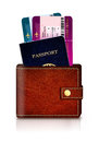 Passport and fly tickets in wallet over white background Royalty Free Stock Photography