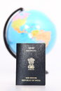 Passport and globe on white background Royalty Free Stock Image