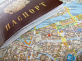 Passport and map a of the city Stock Photography