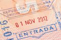 Passport page with Dominican Republic immigration control entry stamp. Royalty Free Stock Photo