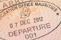 Passport page with mauritius immigration control departure stamp with traditional dodo bird depicted on it Royalty Free Stock Photography