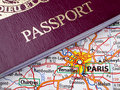 Passport and Paris Map Stock Images