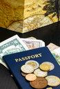 Passport with world currency on wood table Royalty Free Stock Images