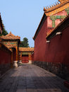 Passway of the palace a in fobidden city museum beijing china with old stone road red walls and yellow roof and Stock Photos