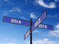 Past and new year roadsign four way metal with future numbers over blue sky Stock Photography