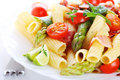 Pasta with asparagus and bacon Stock Images