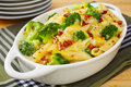 Pasta bake with broccoli penne and a mustardy cheese sauce topped pecan nuts and oven baked a healthy hearty vegetarian meal Royalty Free Stock Photography