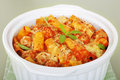 Pasta bake with italian sausage meatballs casserole rigatone tomato sauce and cheese hot and melting Stock Images