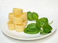 Pasta and basil leaves on a plate Royalty Free Stock Image