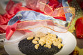 Pasta and black beluga lentils and a pile of gift ribbons Royalty Free Stock Photo