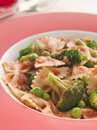 Pasta Bows with Tomato Sauce Broccoli and Peas Royalty Free Stock Photo