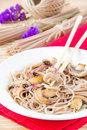 Pasta from buckwheat flour with mushroom and red onion Royalty Free Stock Image