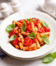Pasta with cherry tomatoes and basil Royalty Free Stock Photos