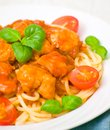 Pasta with chicken breast in tomato sauce Royalty Free Stock Photography