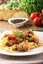 Pasta with chunks of fresh tuna, tomato and mint Royalty Free Stock Images