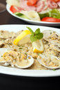 Pasta with clams italian dish fresh over herbs and cheese shallow depth of field Royalty Free Stock Photo