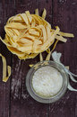 Pasta close up of and grated parmesan cheese on wooden background Royalty Free Stock Images
