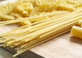 Pasta close up on wooden dask Stock Images