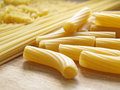 Pasta close up on wooden dask Stock Photos