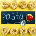 Pasta concept,, Tagliatelle before cooking, Royalty Free Stock Photo