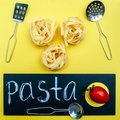 Pasta concept,, Tagliatelle before cooking Royalty Free Stock Photo