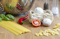 Pasta and different ingredients for an italian cooking Stock Image