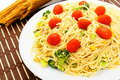 Pasta dish plate of spaghetti with cherry tomatoes and vegetables Royalty Free Stock Photography
