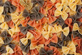 Pasta farfalle multicolor like background texture Stock Photography