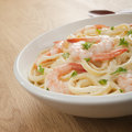 Pasta Fettucine Alfredo  with Shrimp or Prawns Royalty Free Stock Photo