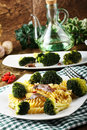 Pasta with fresh broccoli and anchovies on complex background Royalty Free Stock Photos
