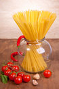 Pasta in the glass pot and tomato Stock Image