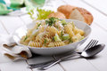 Pasta with gorgonzola cheese and fennel on the white table Stock Image