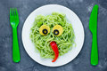 Pasta with green vegetables pesto shaped cute monster - healthy Royalty Free Stock Photo