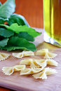 Pasta and greens bowtie with olive oil Stock Photo
